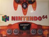 The picture of the Nintendo 64 Clear Orange (Europe) bundle